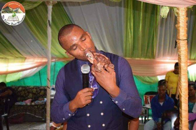 Apostle Kenny eating the Dog's meat Raw