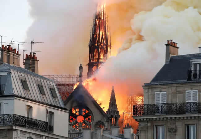 Smoke-billows-as-fire-engulfs-the-spire-of-Notre-Dame-Cathedral-in-Paris