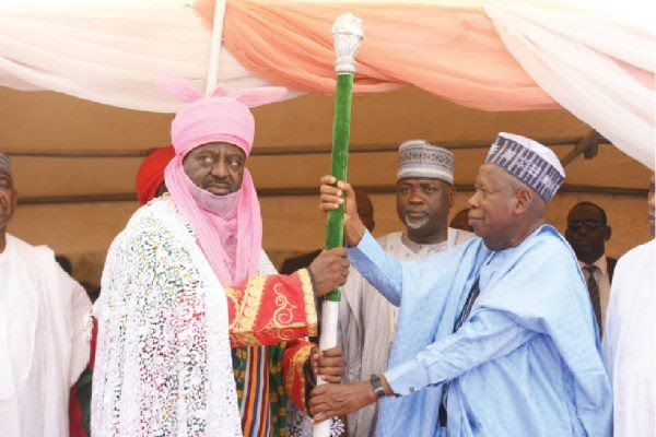 Ganduje-presenting-staff-of-office-to-one-of-the-new-emirs-e1557769134972